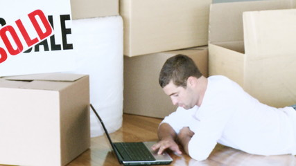 Man using the laptop during his home move