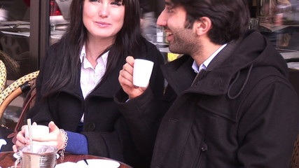 tourists taking a coffee in Paris