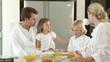 joyfull family speaking during breakfast in the kitchen