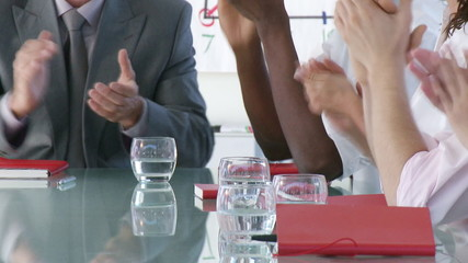 close-up of a businessteam clapping during presentation