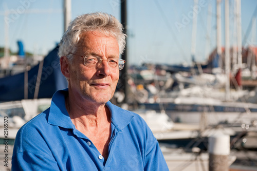 Elderly man in harbor