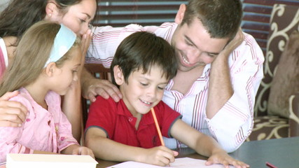 happy family during homework at home