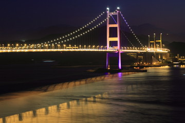 Tsing Ma Bridge by night, key infrastructure in Hong Kong