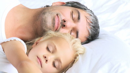 father and daughter sleeping peacefully