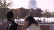 tourists looking at the Eiffel tower