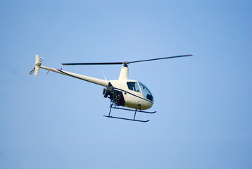 Robinson R-22 helicopter in the air