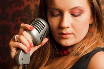 woman hugged hand vintage microphone placed on stand