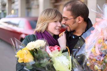 outdoor portrait of man in glasses and beauty blond girl
