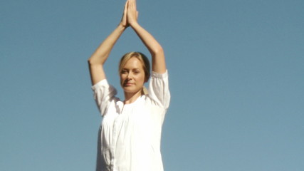 peaceful woman doing yoga outside
