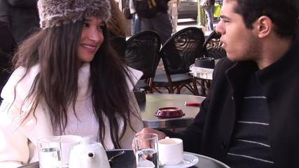 friends sitting in a cafe in Paris
