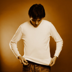 Man are posing in the studio. Sepia tint.
