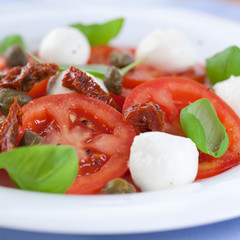 Caprese salad with capers and dry tomatoes