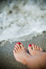 Woman feet - lonely day at the beach