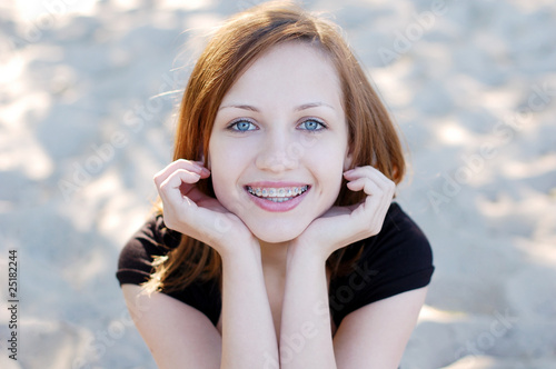 Pretty girl wearing braces smiling cheerfully - 25182244