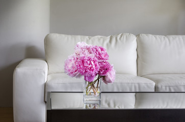 pink peonies in white living room