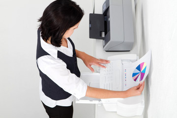 secretary faxing document in office