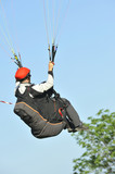 man flying with parachute paragliding