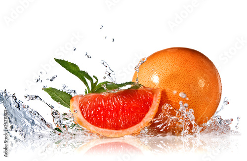 Foto op Canvas Opspattend water Water splash on grapefruit with mint isolated on white