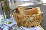 little roll breads in basket on table