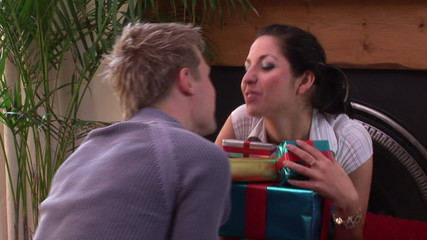 man giving presents to his girlfriend