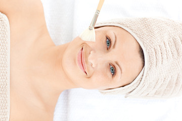 Smiling young woman enjoying a beauty treatment