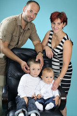 beautiful white family posing in studio