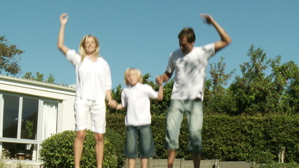 energetic family jumping on a trampoline
