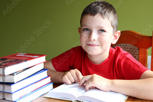 Reading book and doing homework Poster