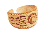 Handicraft carved armlet made of birch bark on white background poster