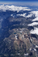 Italy, aerial view of the italian Alps and some clouds