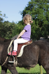 little girl riding