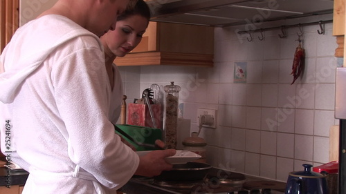 couple cooking together during breakfast