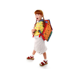 Little funny schoolgirl with backpack