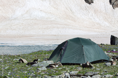 Gray camping tent in mountains.