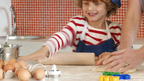 close-up of a boy baking with his mother