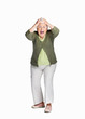 Shocked elderly woman with hands on head isolated against white