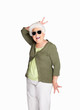Naughty senior female wearing sunglasses isolated against white