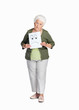 Mature woman holding sheet of sad smiley isolated against white