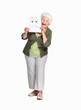 Senior woman holding sheet of sad smiley isolated against white