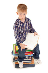 thoughtful little boy with open book
