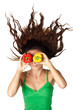 Beautiful woman hold peppers near eyes hair dishevelled isolated