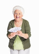 Happy mature woman holding dollars against white background