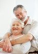 Loving mature man embracing a happy senior woman