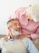 Smiling mature man looking at a loving senior woman