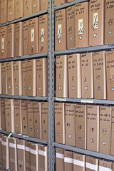 Archive with many folders on a metal shelf