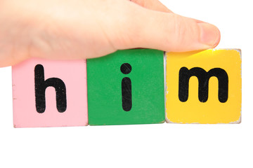 hand holding him in toy play block letters with clipping path