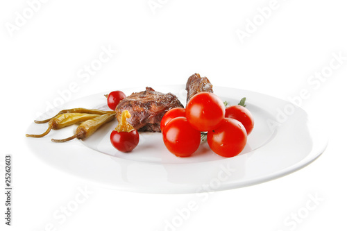 roast meat medallion with cherry tomatoes