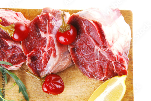 raw meat chunk on wood
