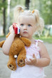 little cube blond girl speaking by toy phone