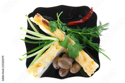 cheese cannelloni served with pepper and olives